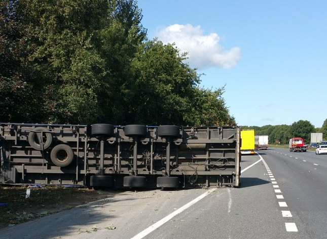 The lorry has overturned just off the carriageway. Picture: Kent Police RPU
