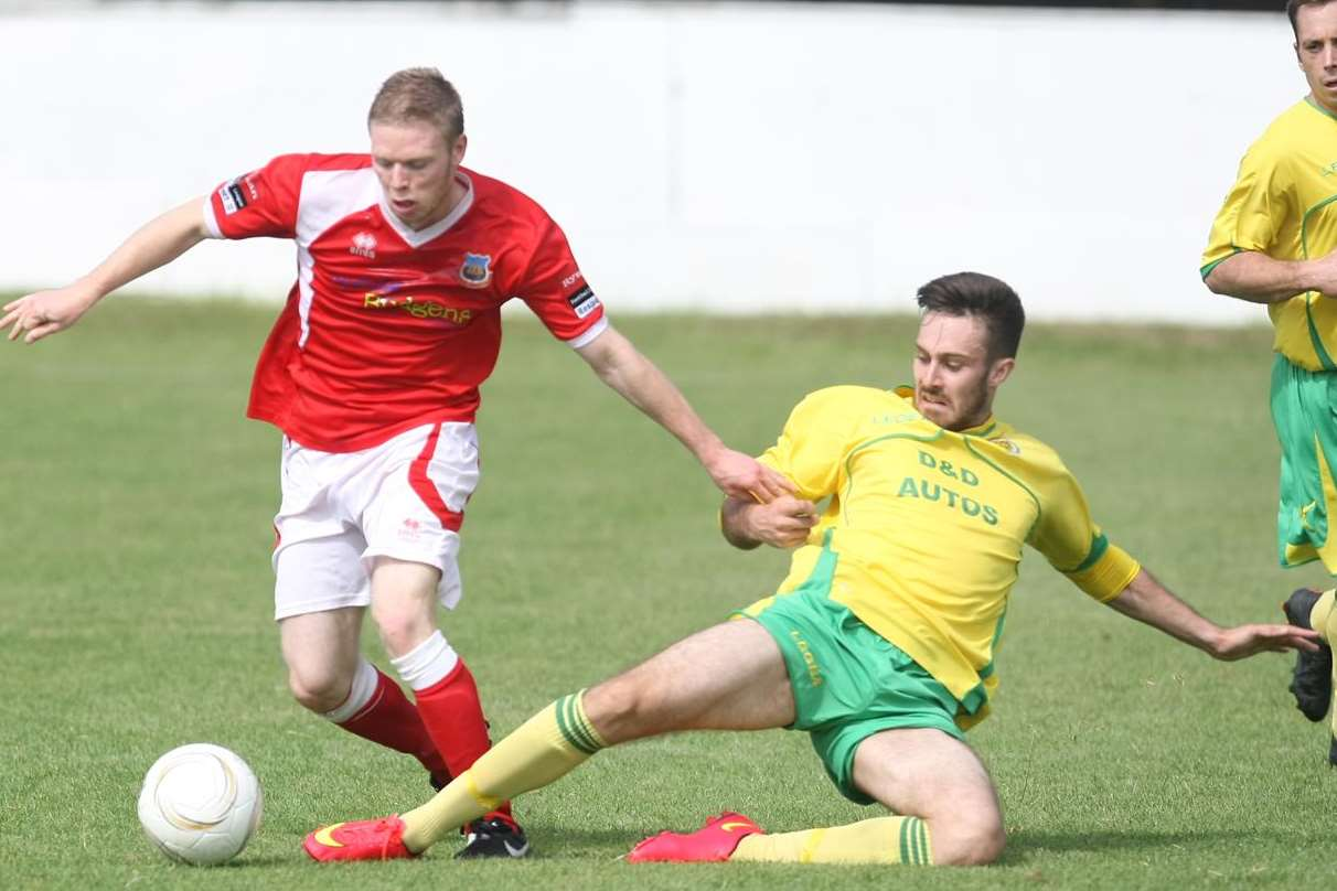 Whitstable's Scott Heard shakes off an Ashford challenge during Saturday's friendly at Belmont. Picture: Matt Bristow