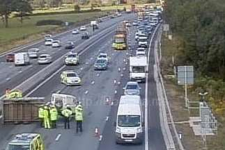 An overturned trailer on the M25, causing delays for Kent motorists