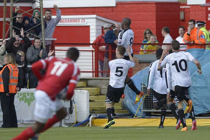 Nathan Elder jumps for joy as Dover celebrate the all-important first goal. Picture: Andy Payton