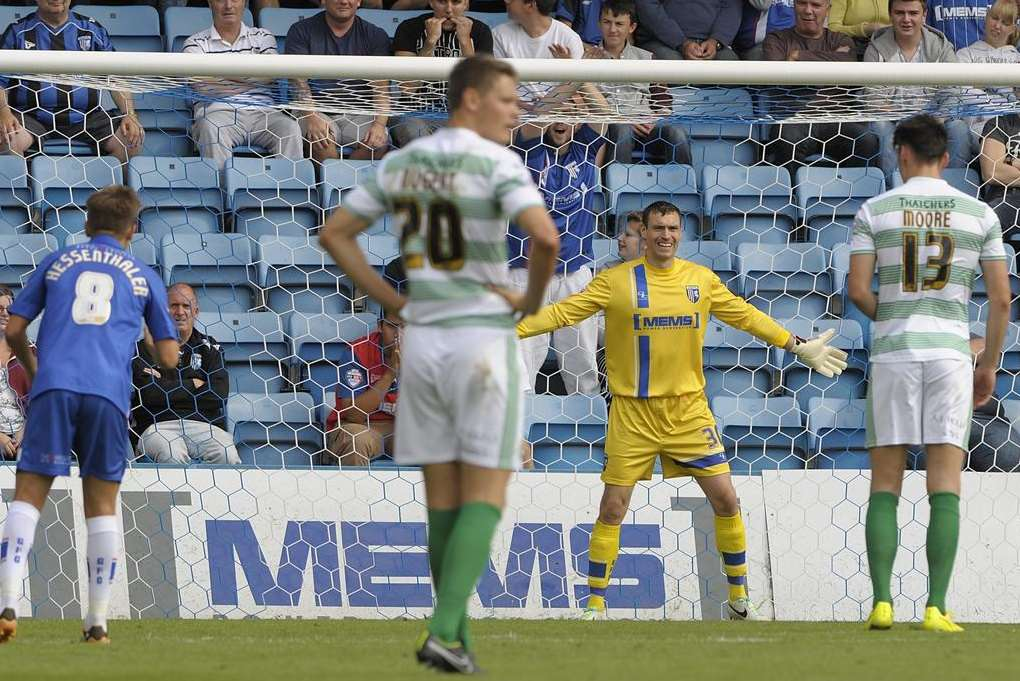 Stephen Bywater prepares to save the Yeovil penalty taken by Kieffer Moore. Picture: Barry Goodwin