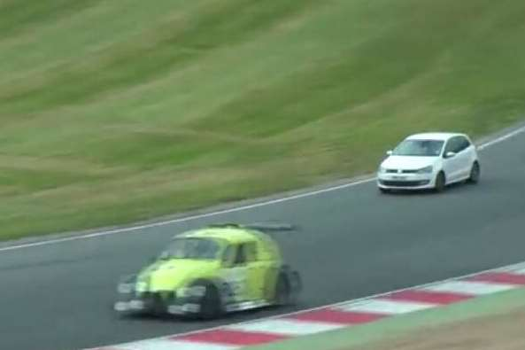 The white VW Polo gate-crashed the race at Brands Hatch