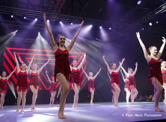 Sapphire Dance Academy, senior team performing at Move It dance exhibition at London's ExCel Centre. Credit: Fiona Whyte Photography.