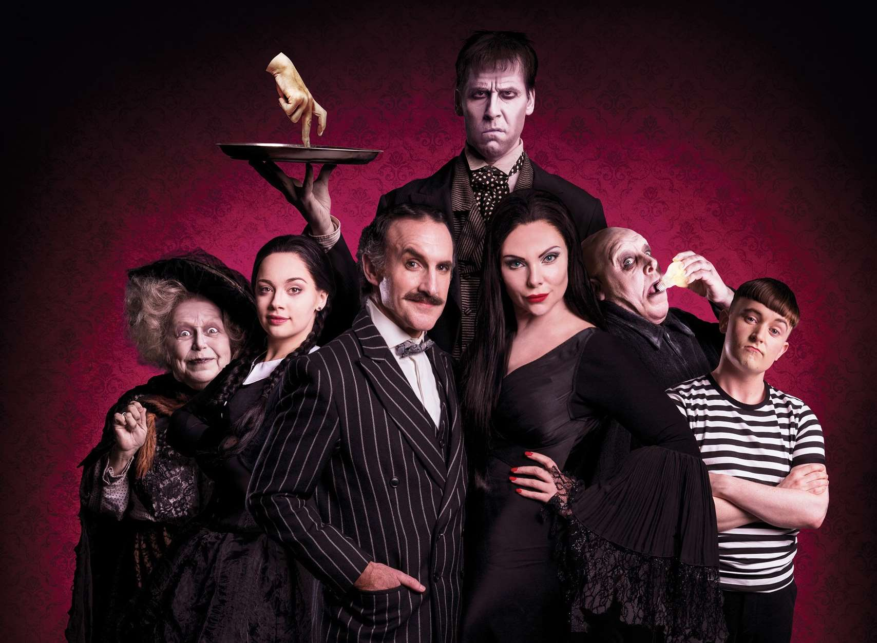 Valda Aviks, Carrie Hope Fletcher, Cameron Blakely, Dickon Gough, Samantha Womack, Les Dennis and Grant McIntyre in the Addams Family. Picture: Matt Martin