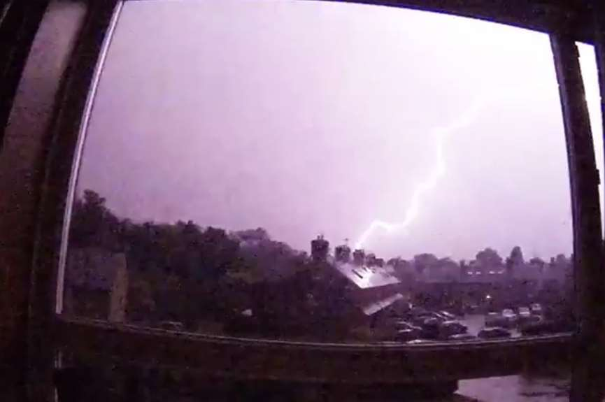 The skies light up above Tonbridge in a lightning strike. Picture: James Miller