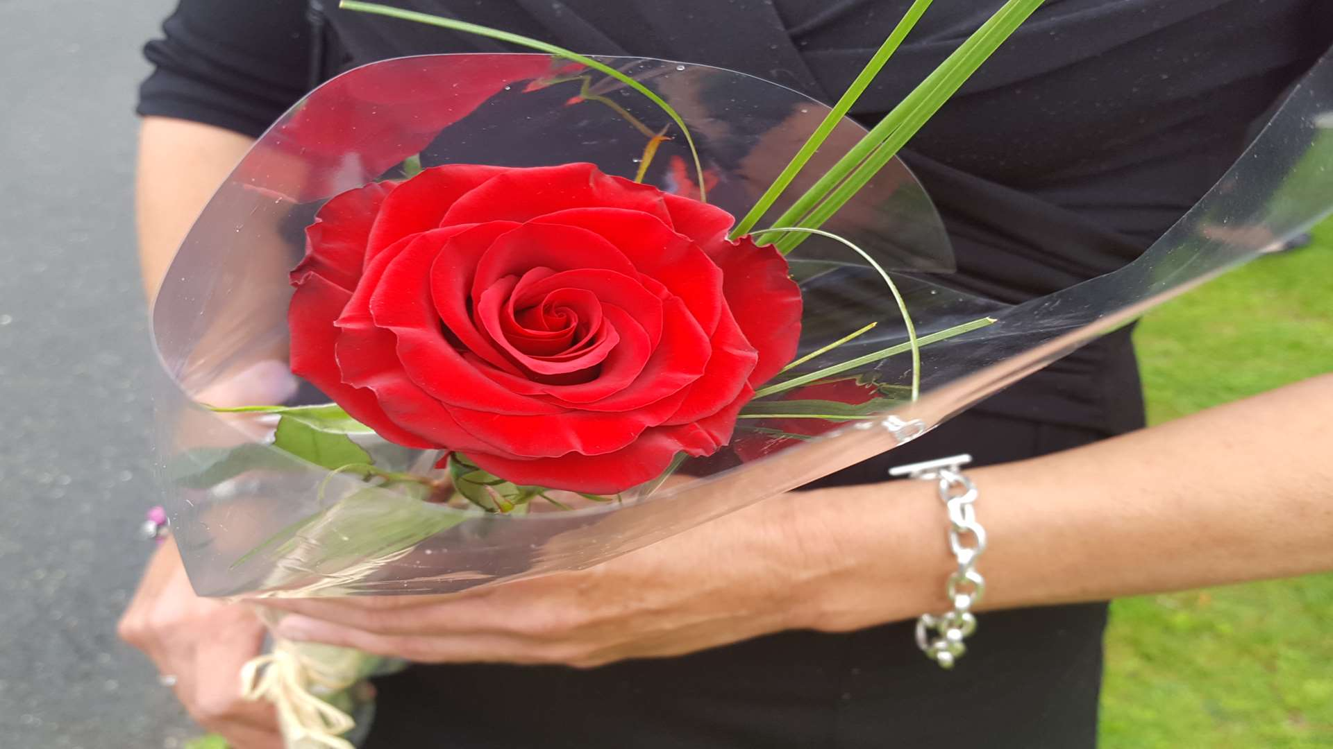 A rose is held as tribute to tragic Taiyah