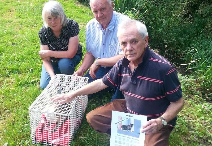 David Gwyn-Jones with his remaining cat Tom and others helping with the search Jenny and Roger Chatfield.