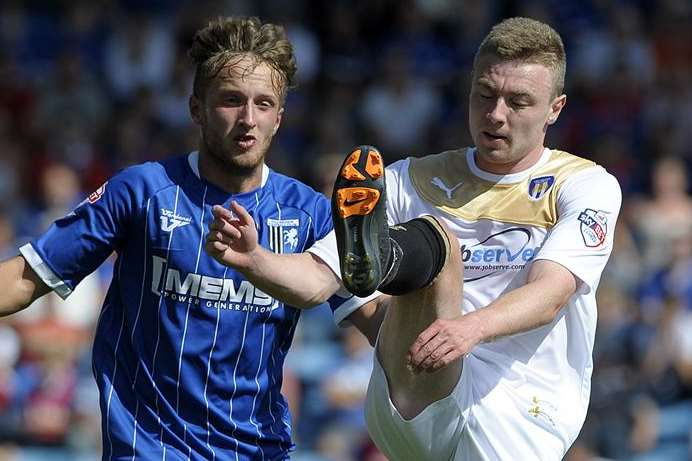 Stephen Butcher (left) in League 1 action for Gillingham against Colchester Picture: Barry Goodwin