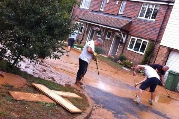 Residents of Paygate off Sutton Road spent nine hours cleaning up after flooding on Sunday