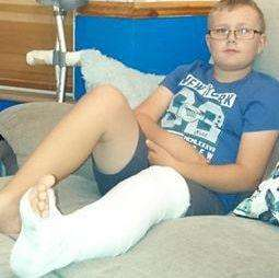Injured Damien, 10, was left in plaster and still suffers pain