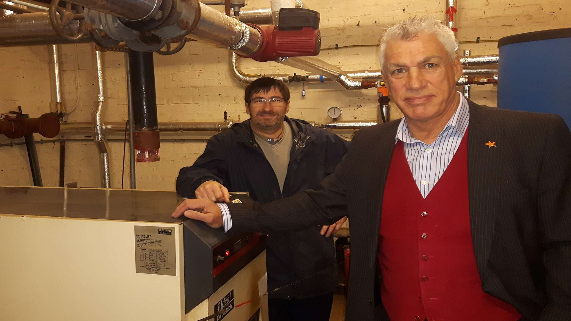 Head teacher Stuart Pywell and caretaker Keith Burgess in the school's boiler room