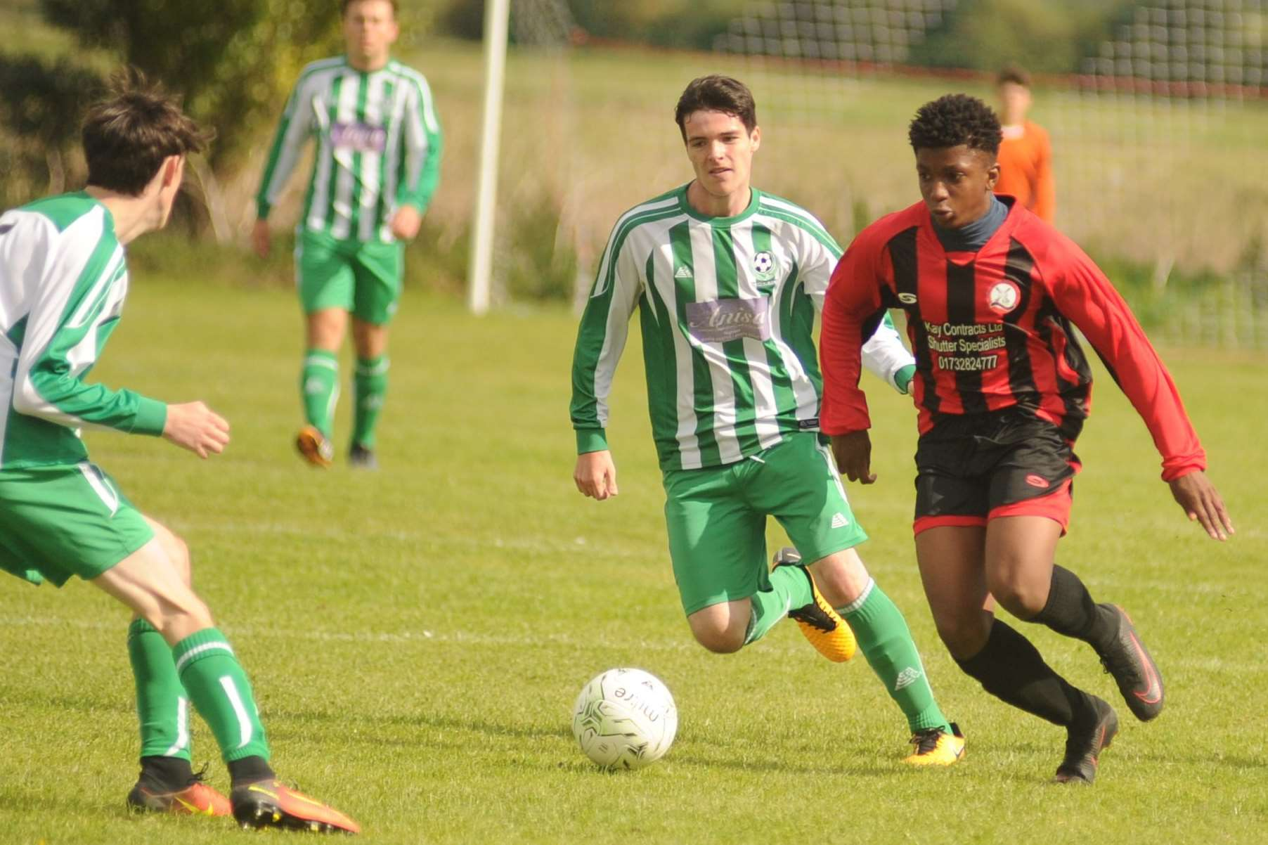 Meopham Colts Black under-18s (red) up against Eagles in the League Cup Picture: Steve Crispe