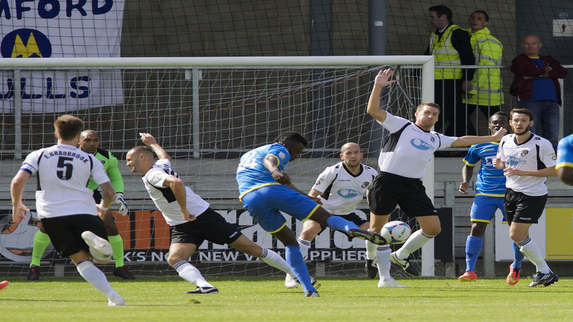 Dartford do their best to block this strike from Torquay's Duane Ofori-Acheampong Picture: Andy Payton