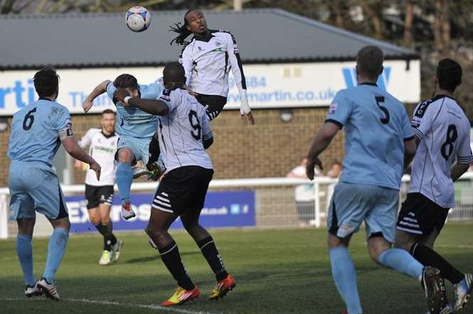 Dover striker Ricky Modeste heads the ball on against Boreham Wood. Picture: Tony Flashman