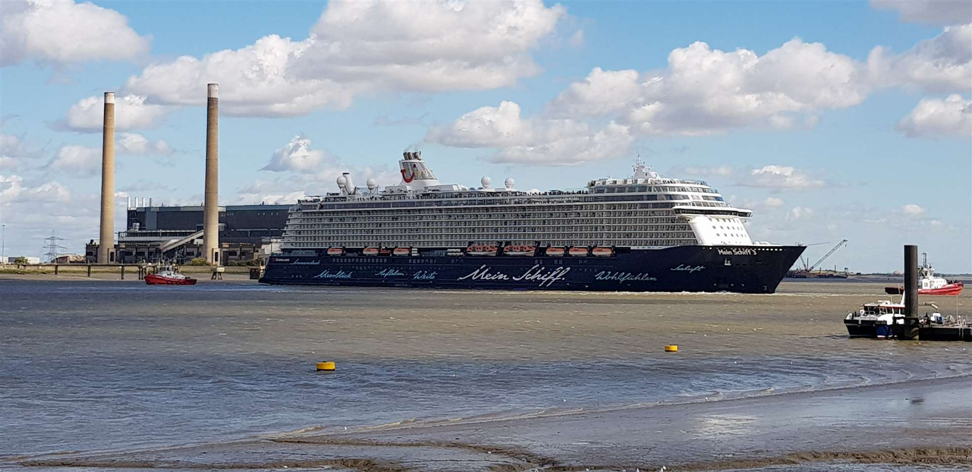 Cruise ship TUI Mein Schiff 3 prepares to head out to sea after being delayed by high winds.