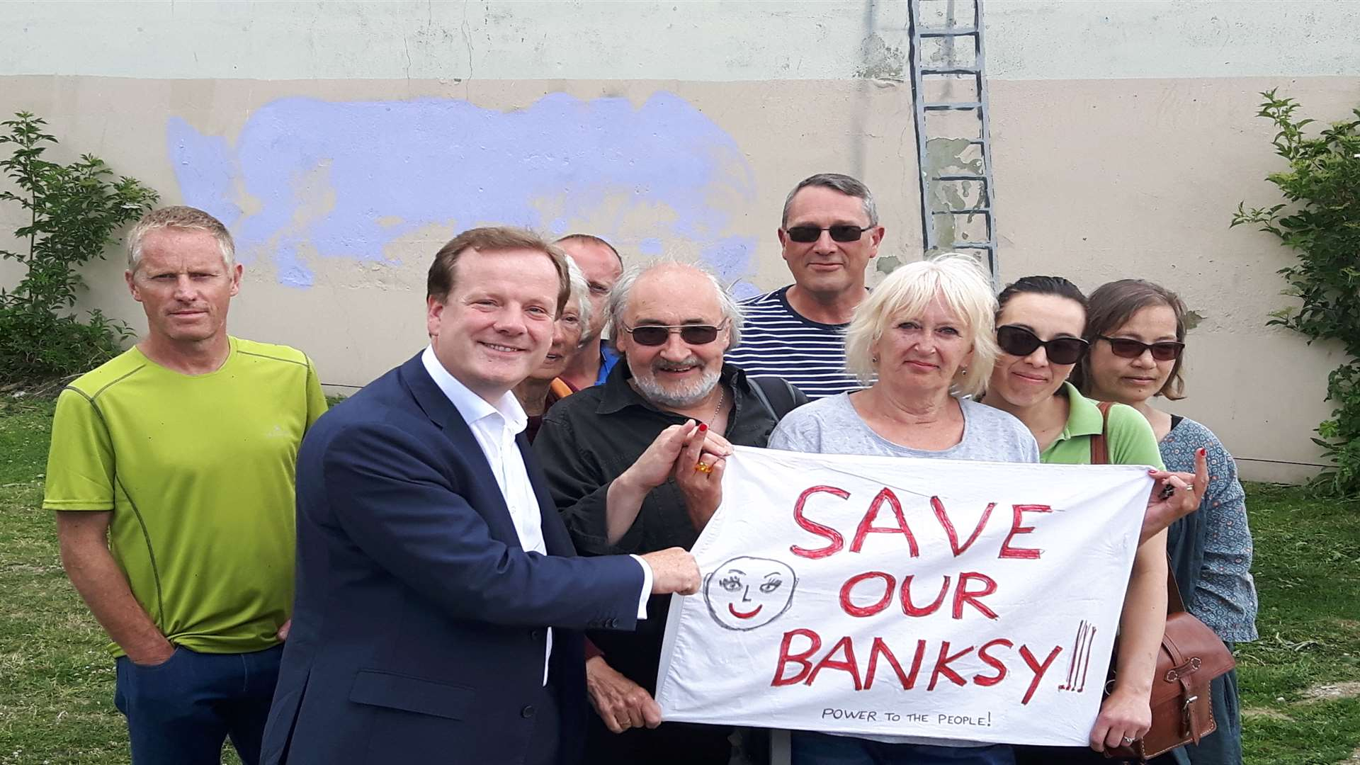 Charlie Elphicke launches his Save our Banksy campaign at the site of the artwork on the corner of Townwall Street and York Street, Dover