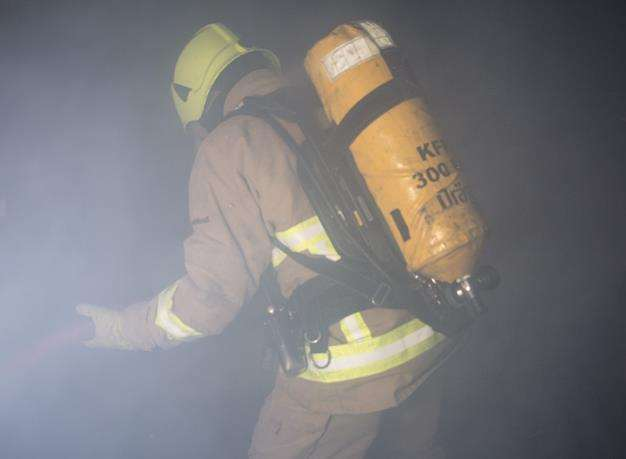 Firefighters needed to wear breathing gear. Stock image