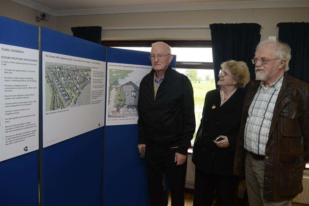 Residents Raymond and Georgina Reveley and Paul Hayes of the Halfway Houses Residents' Association examine the plans for the new housing development