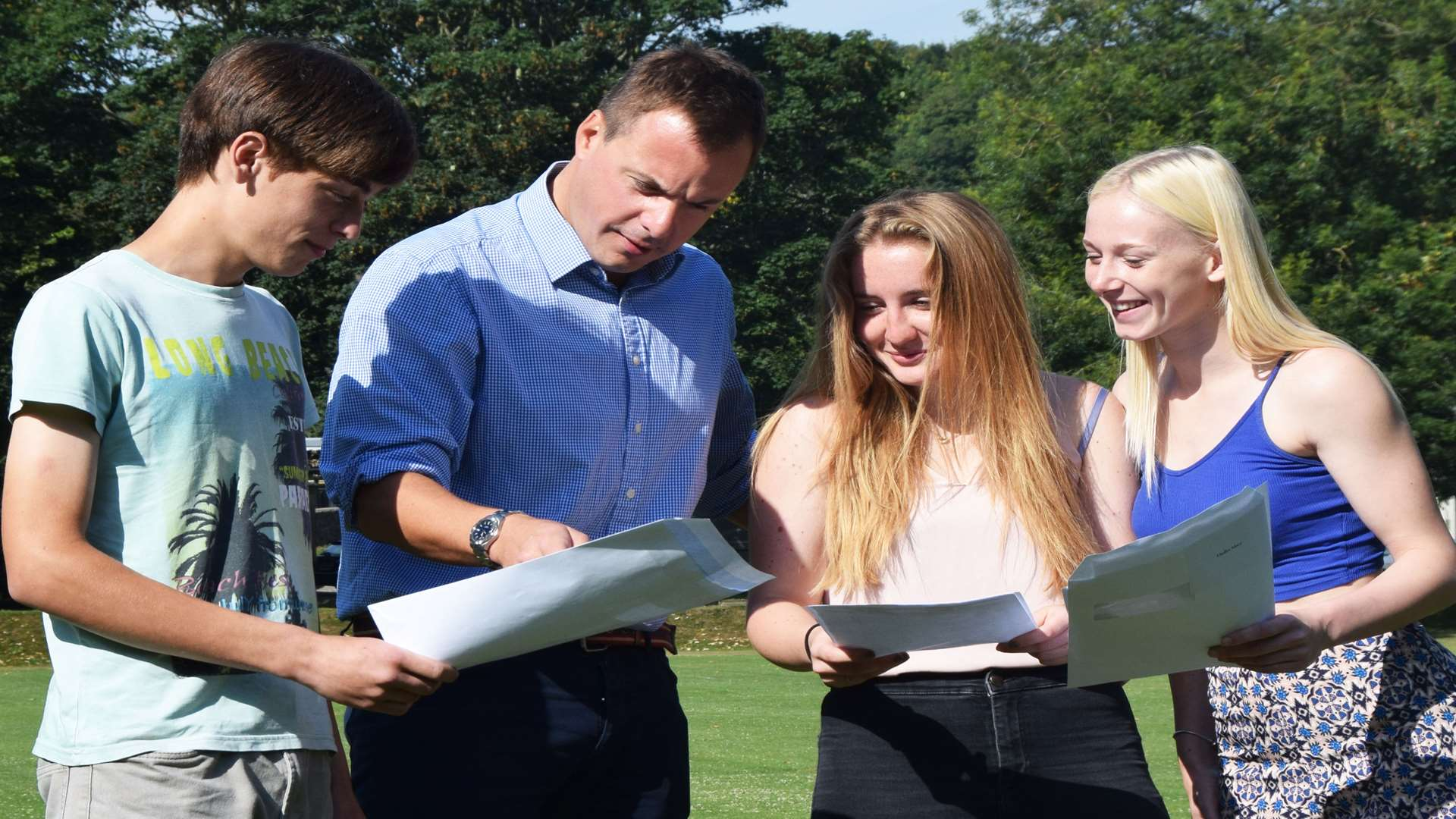 Dover College GCSE results. Pictured, from left, pupil Zach Rogers,headmaster Gareth Doodes and pupils Cordelia Gaskin and Macy Hadler.