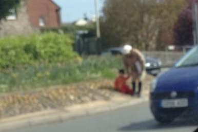 A woman captured on camera dragging a young child into traffic at the busy Wincheap roundabout