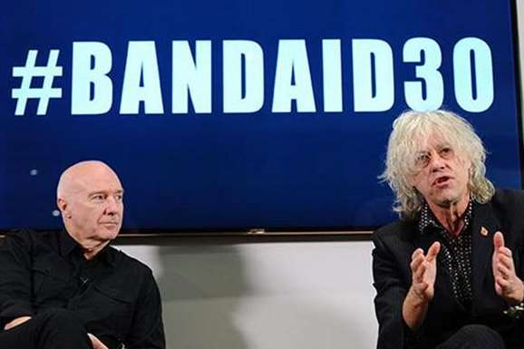Midge Ure and Bob Geldof during press conference