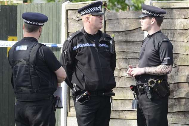Officers gather in Herne Bay where a man was found ablaze. Picture: Chris Davey