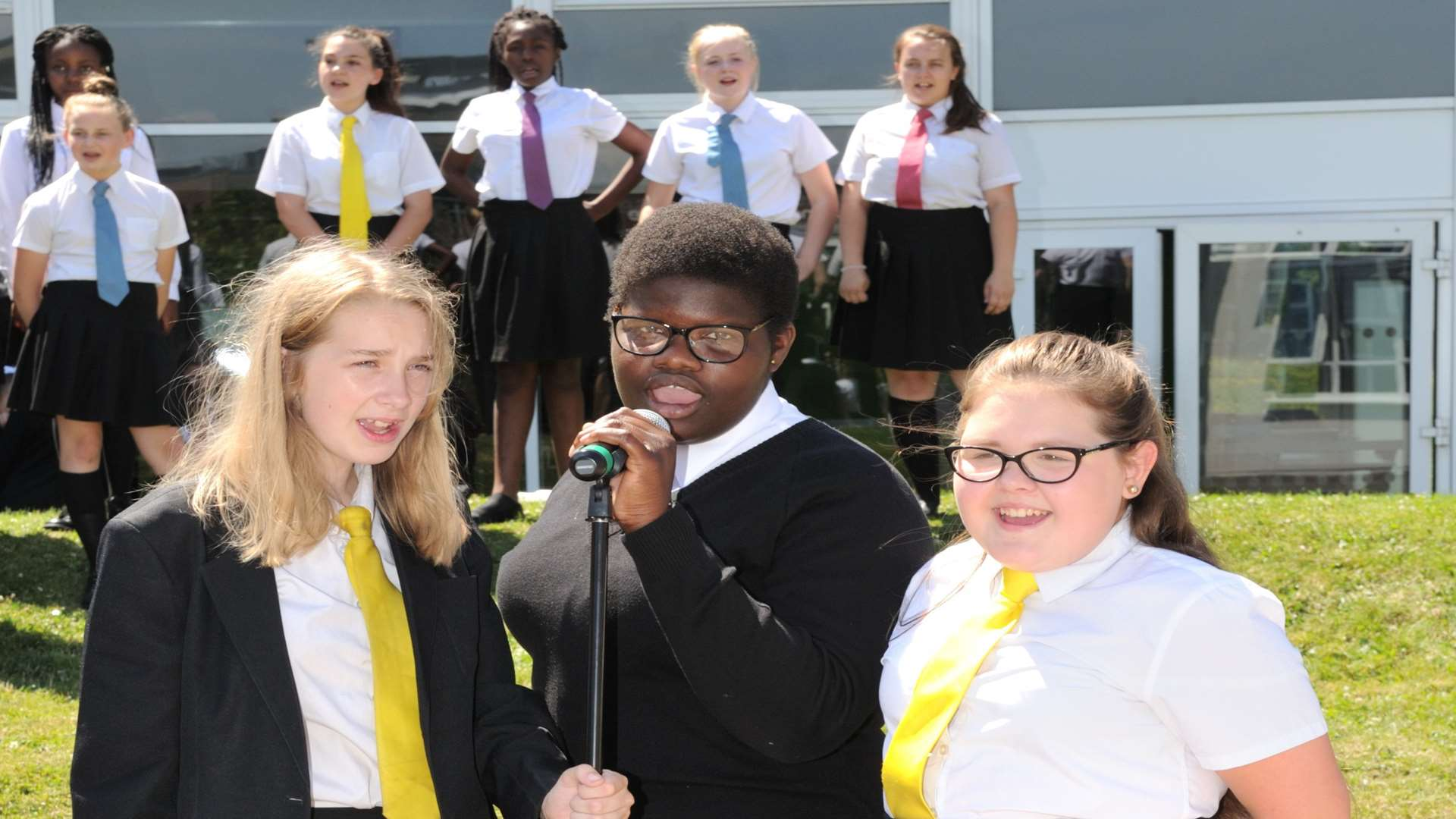 The youngsters sang and performed on the school field. Picture: Simon Hildrew