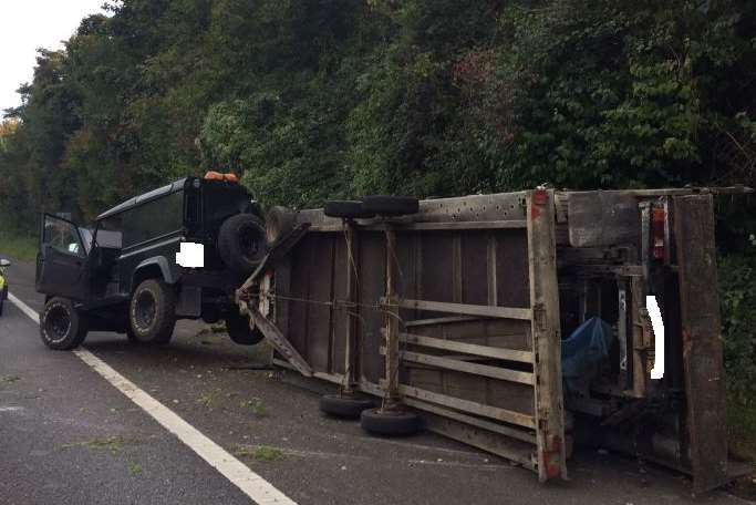 The car and overturned trailer. Picture: Highways England