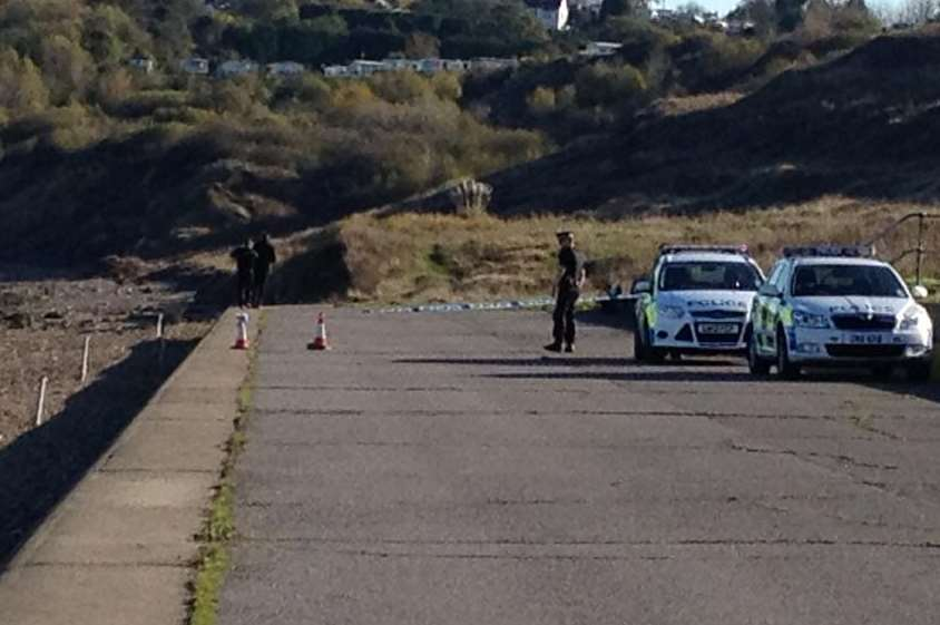Police at the spot where the body of Lewis O'Neill-Smith was found on Minster Beach