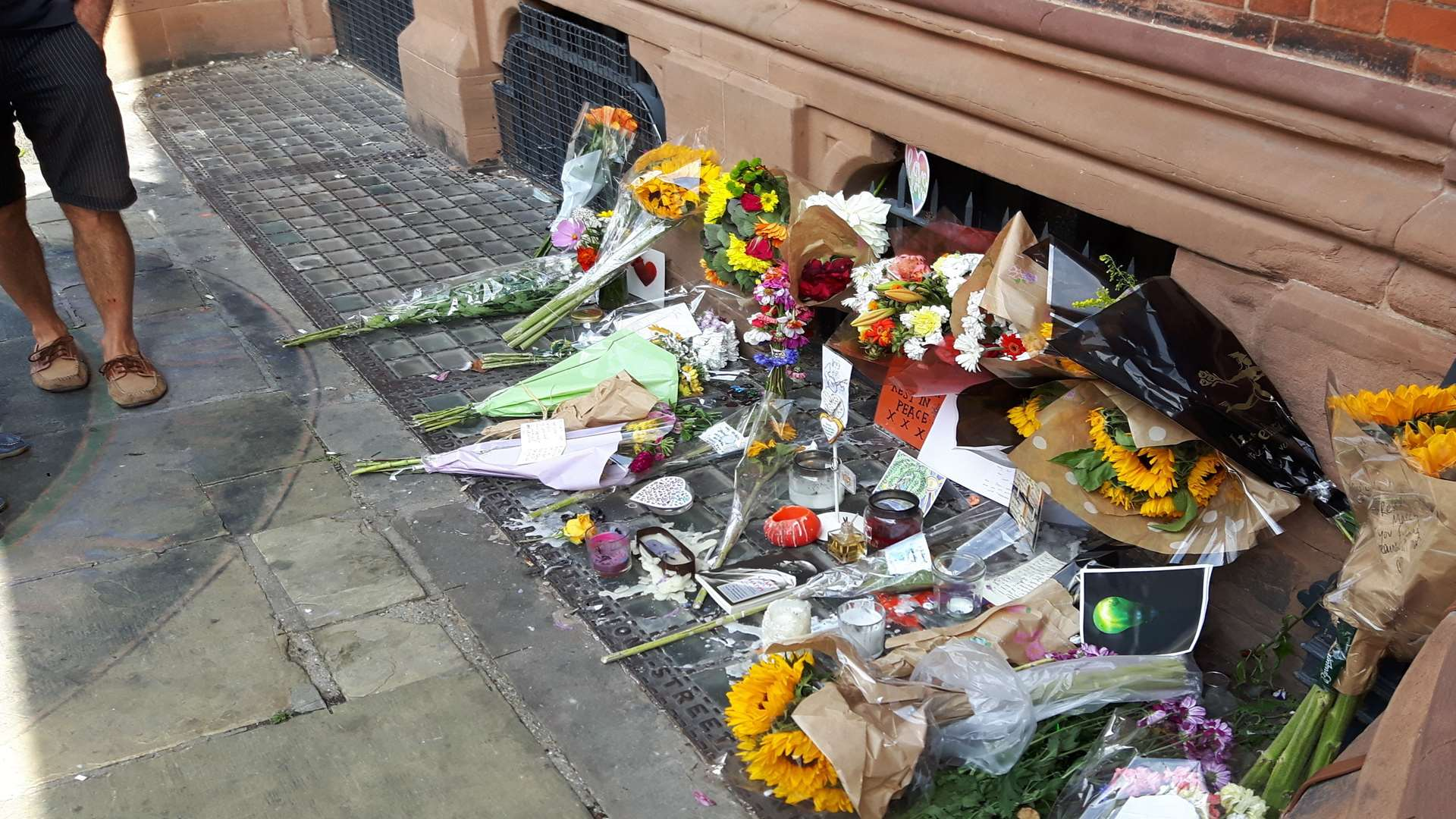 Floral tributes to Maximum Martin, James Truscott and Joshua Lambert-Price outside the Beaney