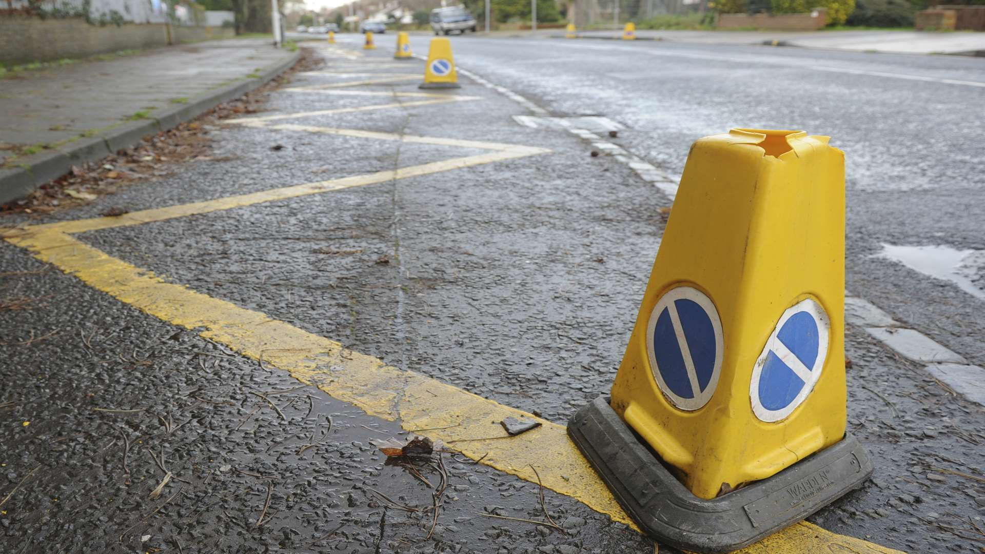Zig Zag lines and cones near a school. Stock image