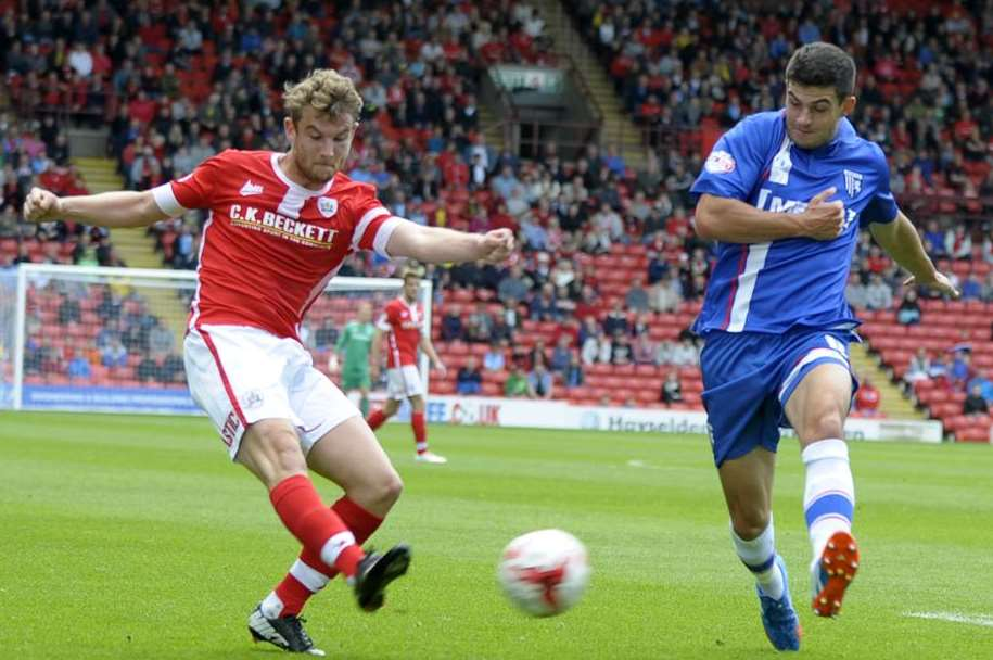 Gillingham defender John Egan in action during the 4-1 defeat at Oakwell this season Picture: Barry Goodwin