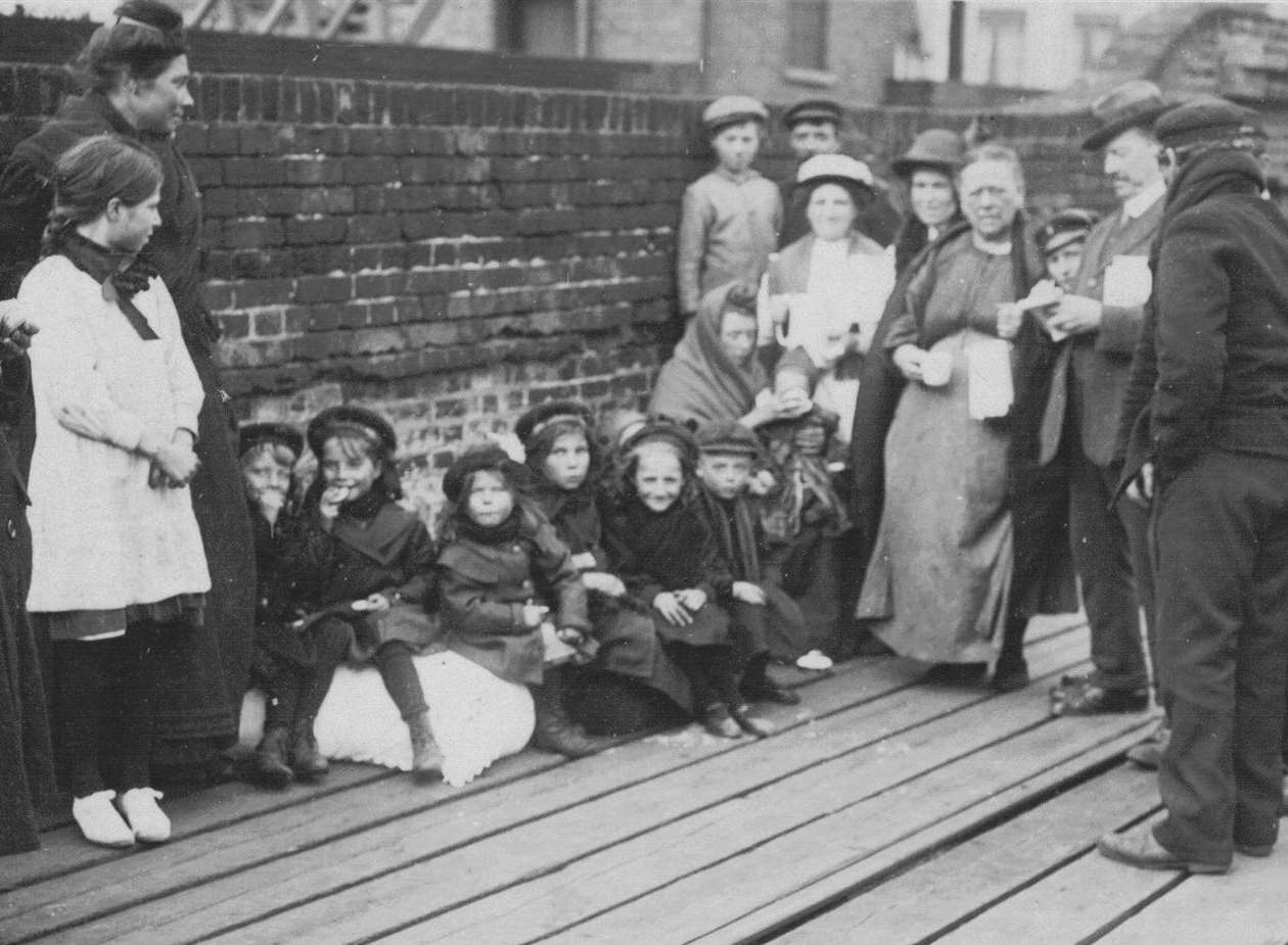 The Belgian families families seen here are on the wooden jetty at the side of the railway branch line to the harbour. Picture courtesy of Alan Taylor