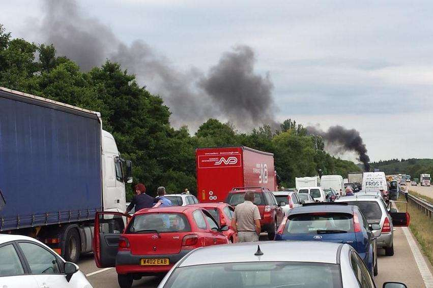 Smoke is clearly seen above the queues on the M20. Picture: @emsalmon