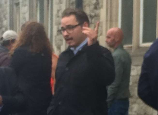 Jordan Brachio, with black coat and glasses, appeared before magistrates