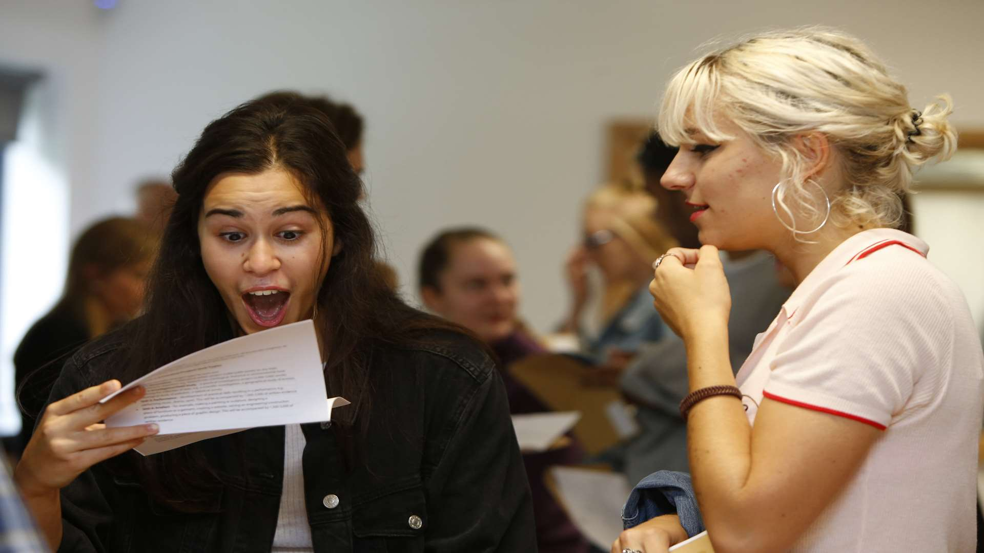 Carys Morgan, left, picks up her A-level results with May Oney at Valley Park secondary school in Maidstone