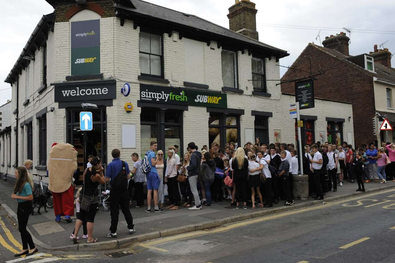 People queue for the new Subway store inside Simply Fresh in Whitstable Road