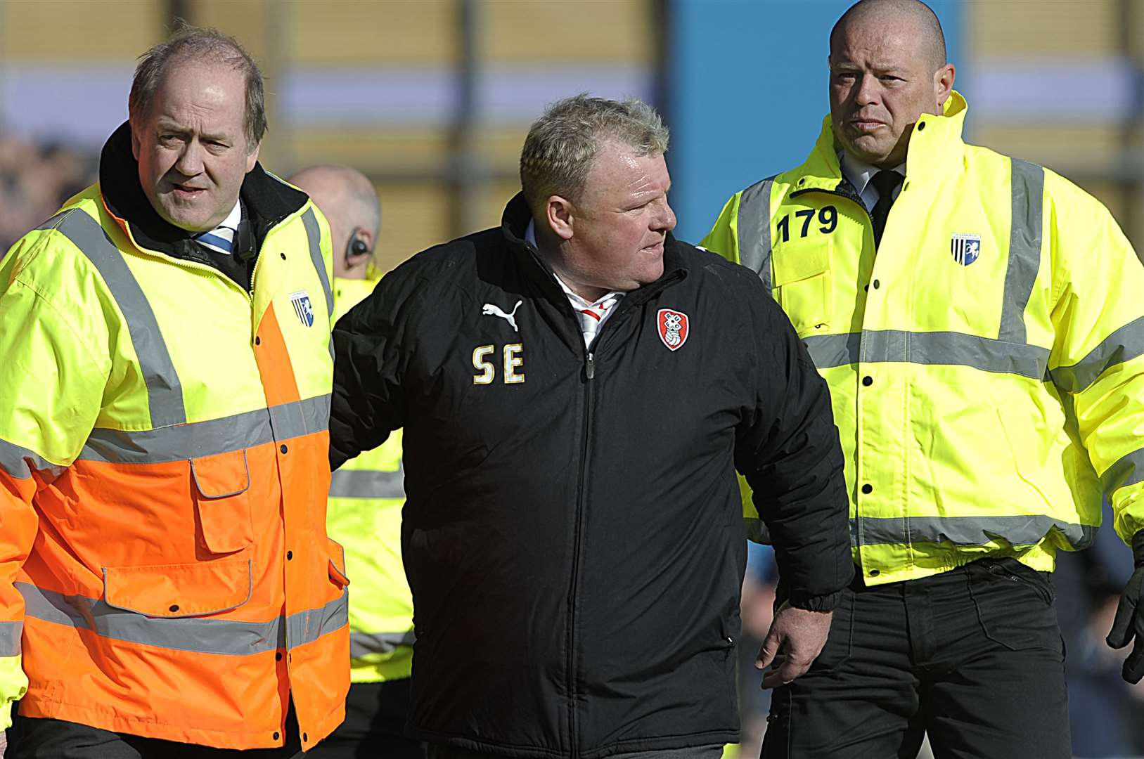 Rotherham manager Steve Evans is escorted from the pitch by stewards for his own safety on a previous visit Picture: Barry Goodwin