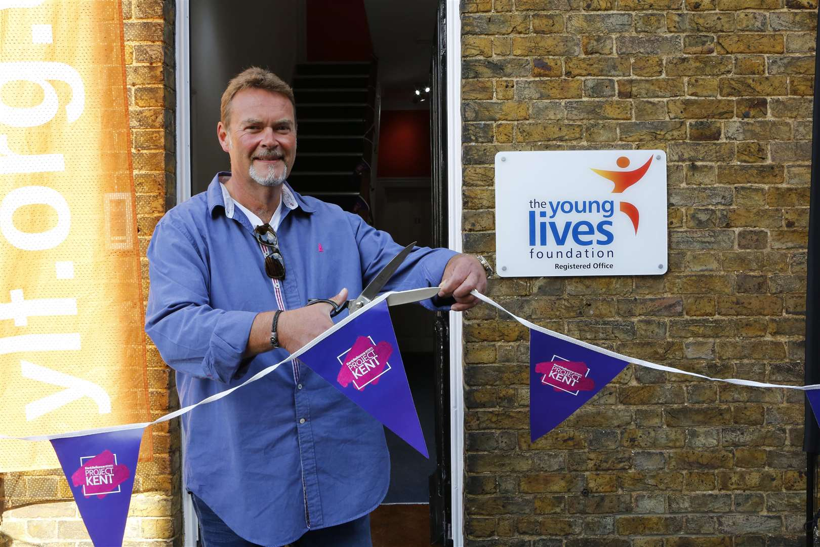 Project Kent's Grand Opening! kmfm's Project Kent with Kent Reliance. Andy Golding from Kent Relliance cuts the ribbon at Young Lives Foundation .Picture: Andy Jones (4165019)