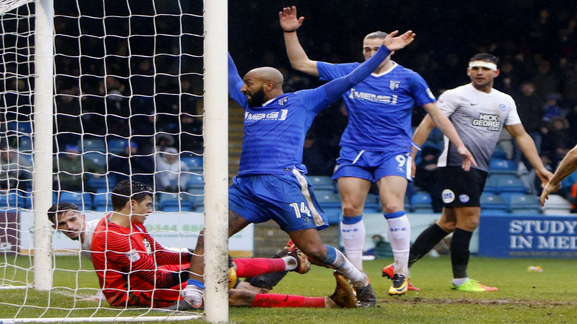 Gillingham's Josh Parker claims his second-half effort has crossed the line. Picture: Andy Jones