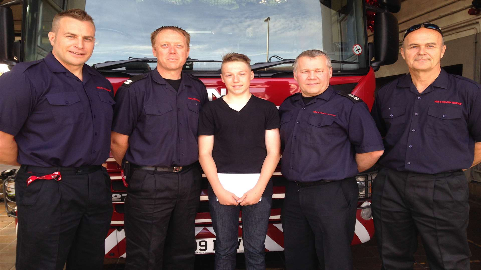 Ryan Smith, 16, with members of Red Watch at Medway Fire Station