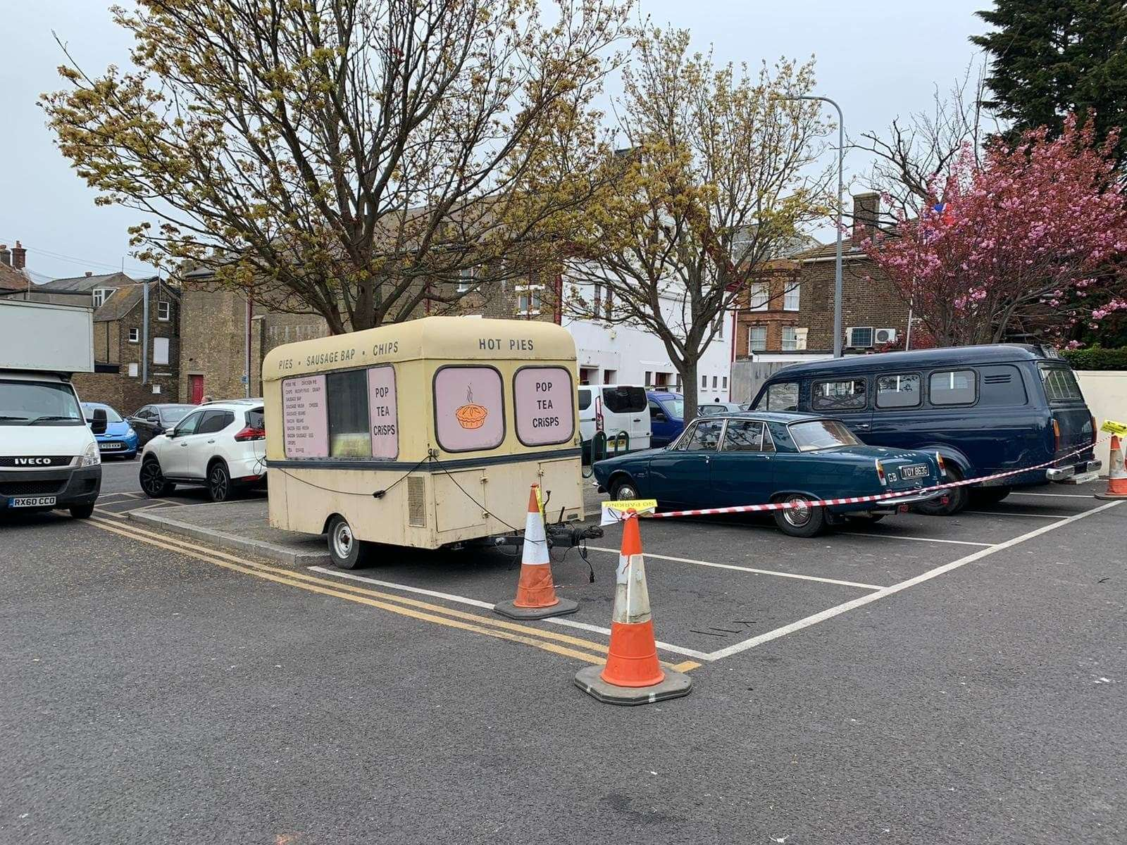 Period vehicles for the filming. The car is a Rover P6 and the van, a Ford Transit