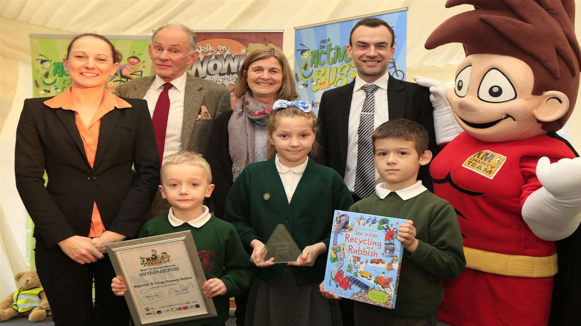 Kent wide Top WOW School winners Bapchild and Tonge Primary School at the KM Walk to School Awards with mascot Wowzer and supporters from Three R's Teacher Recruitment, Kent County Council and Countrystyle Recycling at Commissioner's House, Historic Dockyard, Chatham.