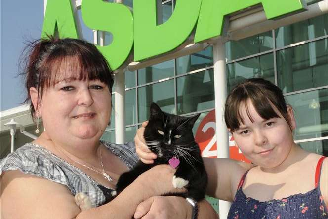 Daisy with owners Nicki Wright and daughter Megan outside Asda