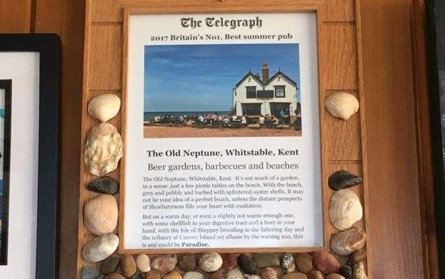 Pride of place on one wall and one picture that isn't for sale, this framed testimonial declaring it to be The Telegraph's number one summer pub in 2017