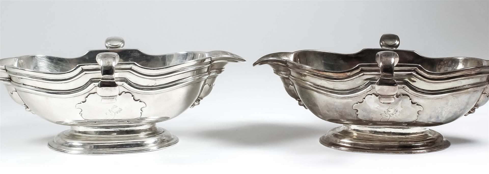 A pair of George I Irish silver sauce boats by Mathew Walker sold for £76,000