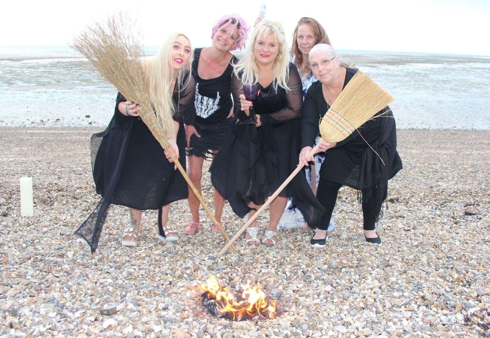The witches of Sheppey with Charlotte Clark, centre, on the beach at Minster celebrating Lammas