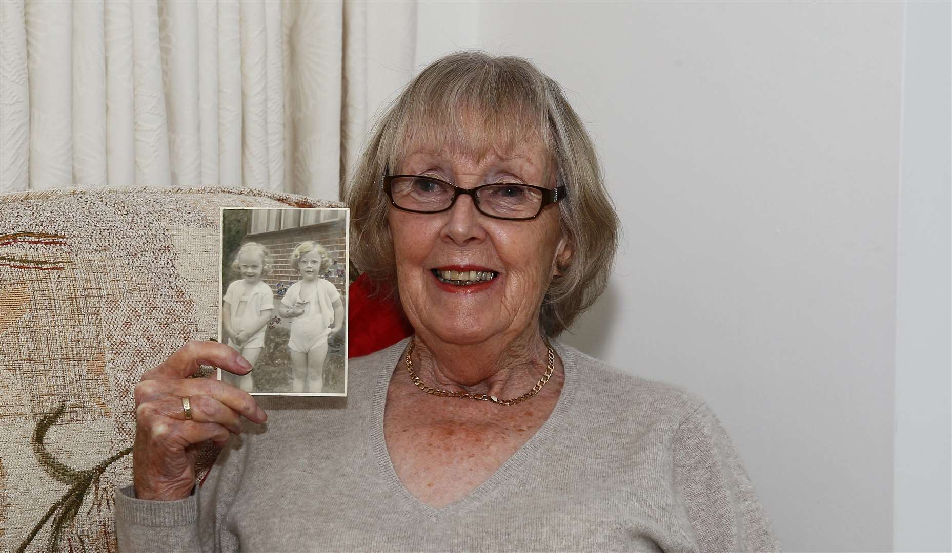 Helen Mill of Oakwood Court Maidstone has been sharing her memories of the war, with a picture of her (right) and her twin sister Wendy as a child.Picture: Sean Aidan (10537965)