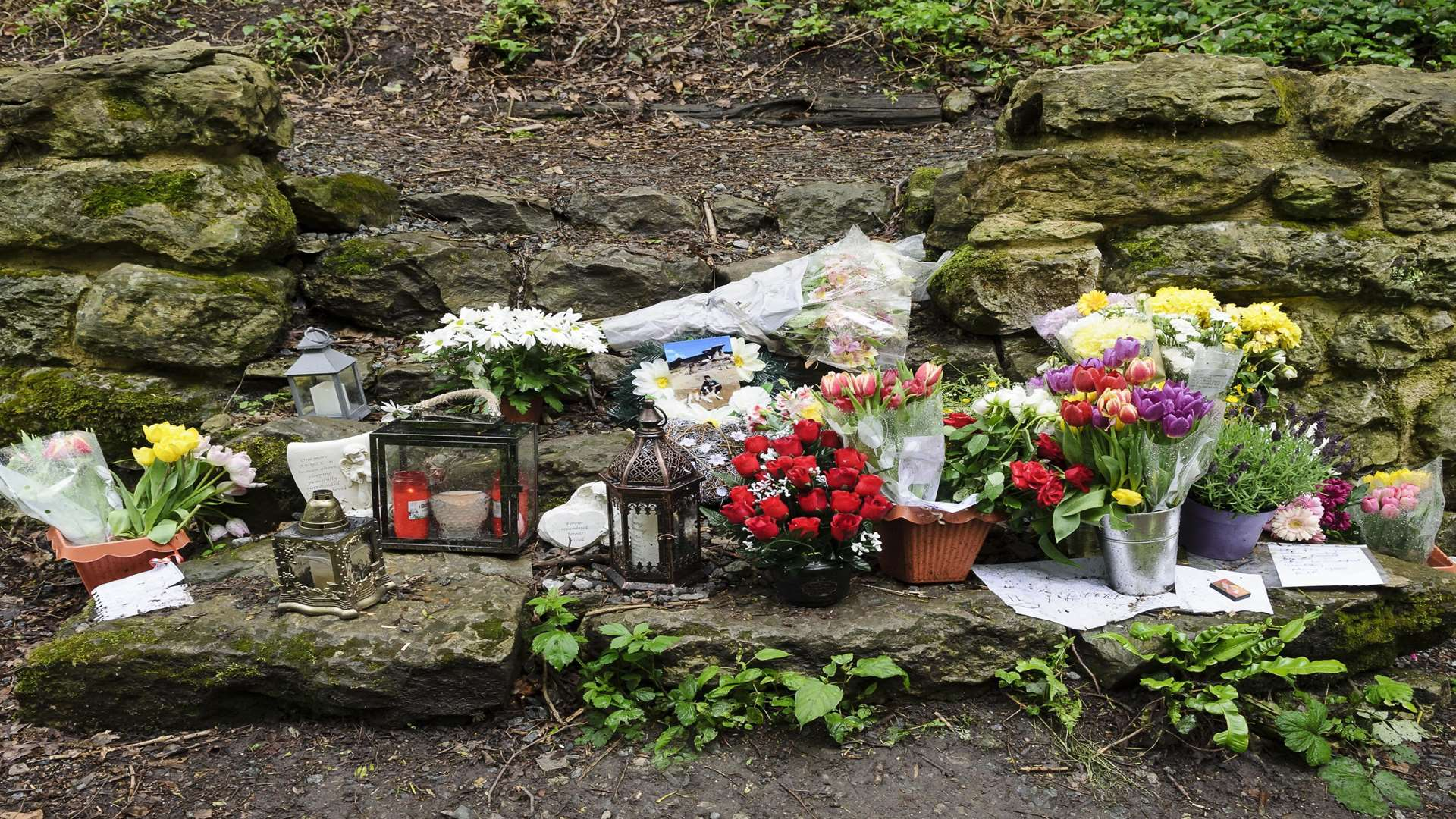 Flowers, lanterns and other items were left in tribute to 21-year-old Razvan Sirbu