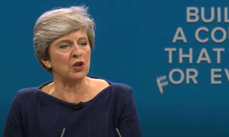 Letters fall down behind Theresa May during her Tory party conference speech in 2017